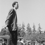 Mario Savio (in socks) speaking from top of police car by Steven Marcus